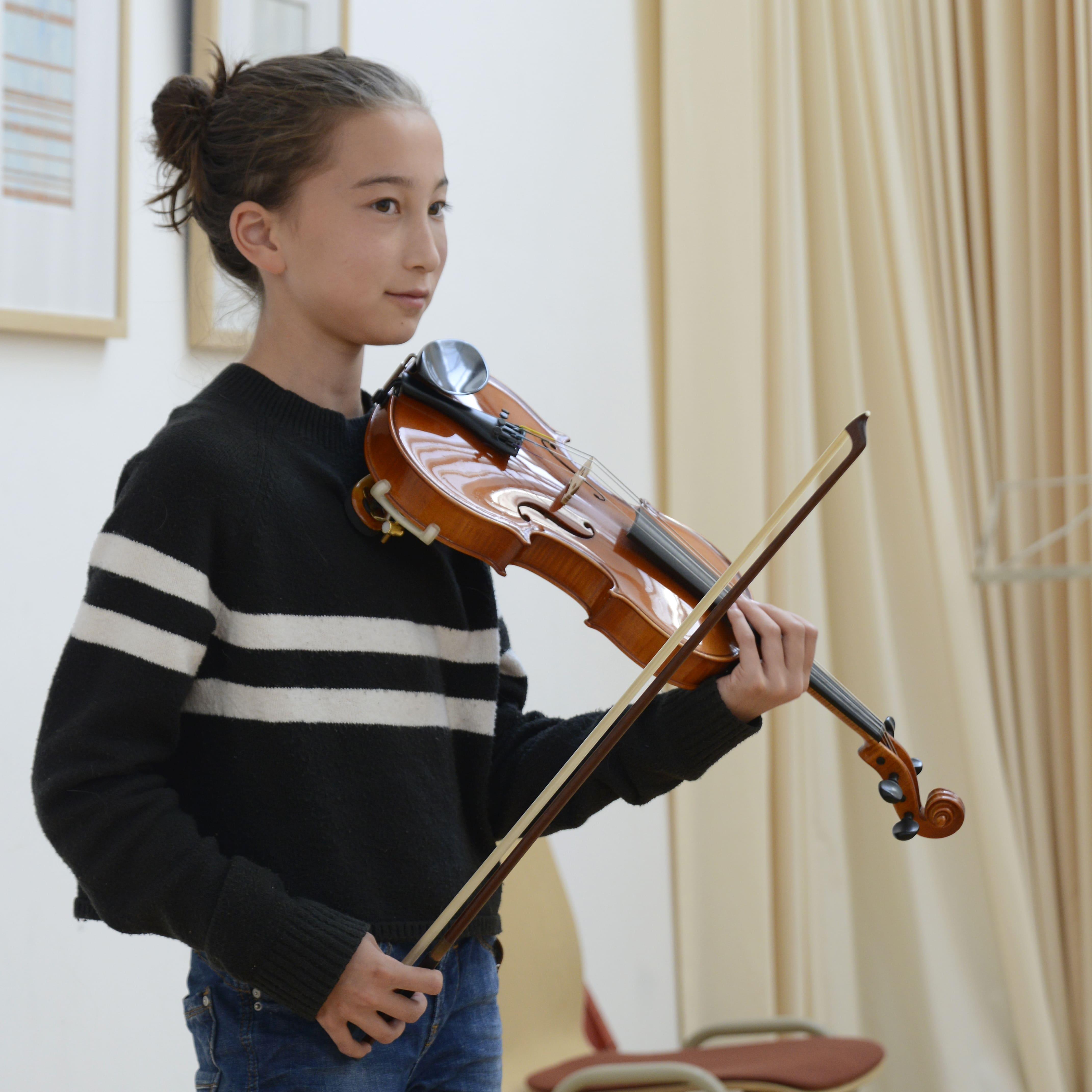 Vioolles met een leerling